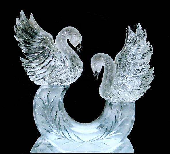 swans ice carvings magical wonderlande